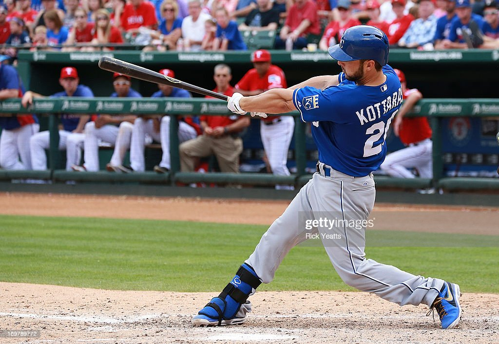 <a gi-track='captionPersonalityLinkClicked' href=/galleries/search?phrase=George+Kottaras&family=editorial&specificpeople=730633 ng-click='$event.stopPropagation()'>George Kottaras</a> #26 of the Kansas City Royals hits a double into right field bringing in Eric Hosmer #35 and Billy Butler #16 to score against the Texas Rangers at Rangers Ballpark in Arlington on June 1, 2013 in Arlington, Texas.
