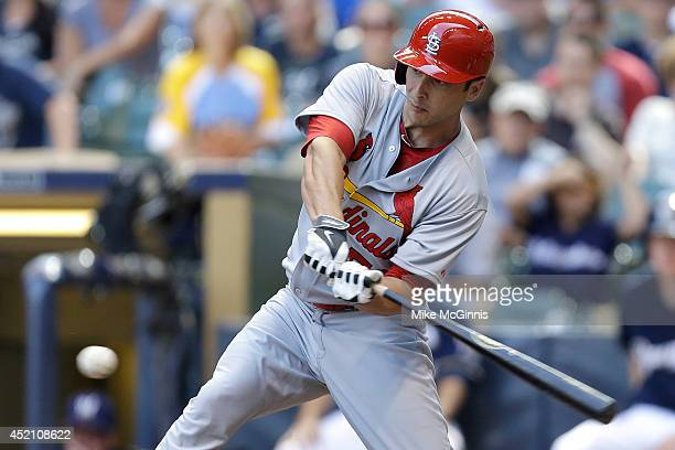 George Kottaras of the St Louis Cardinals hits a RBI single in the top of the ninth inning against the Milwaukee Brewers at Miller Park on July 13...