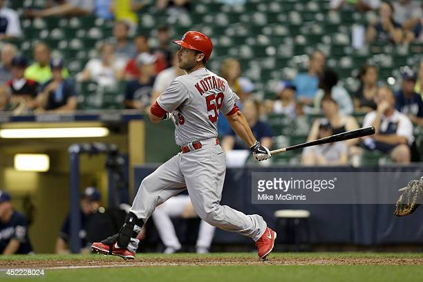 George Kottaras of the St Louis Cardinals makes some contact at the plate during the game against the Milwaukee Brewers at Miller Park on July 12...