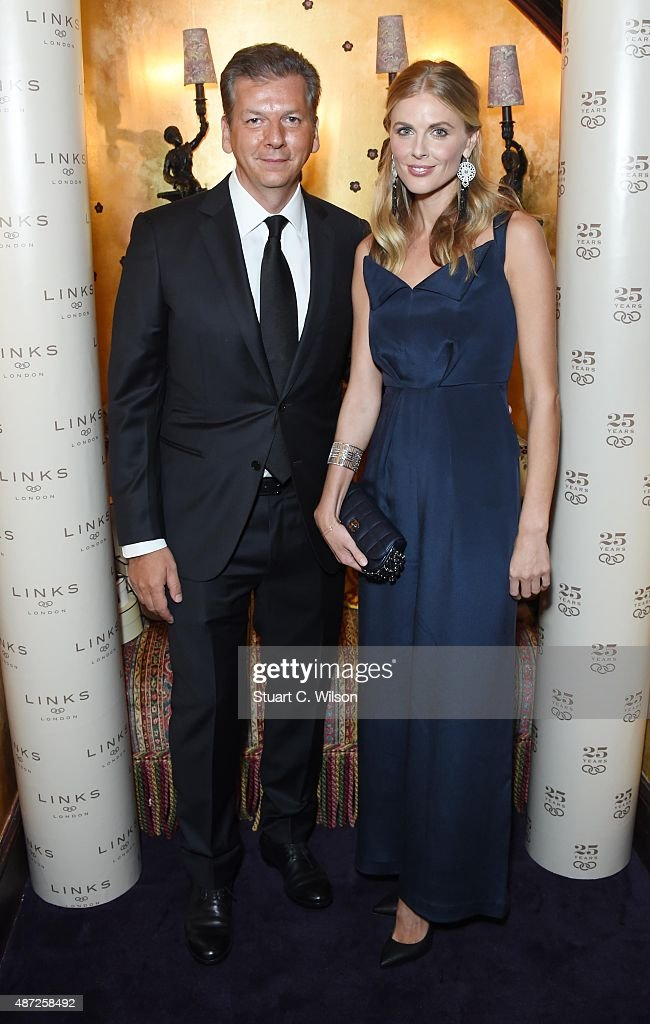 George Koutsolioutsos and Donna Air attend the Links Of London 25th Anniversary Event at Loulou's on September 7, 2015 in London, England.