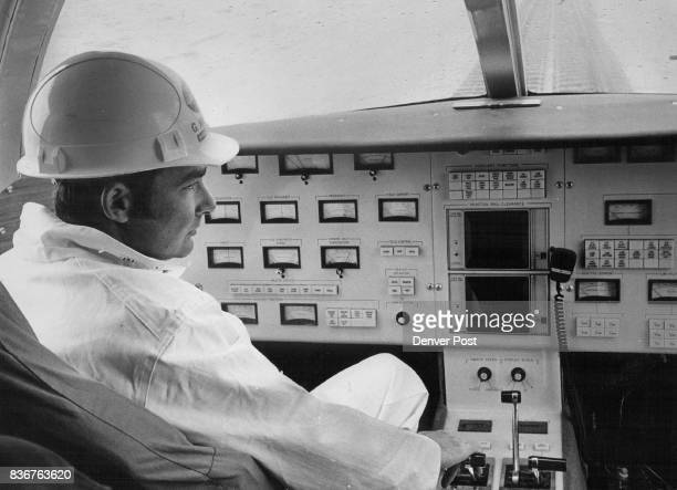 George Kratzer vehicle engineer sits at the controls of the linear induction motor his hand on throttle Vehicle can be driven either from inside its...