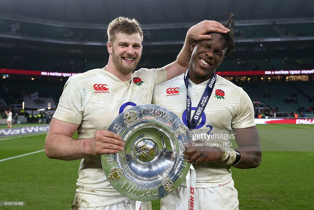 George Kruis and Maro Itoje of England celebrate with the Triple Crown trophy after the RBS Six Nations match between England and Wales at Twickenham...