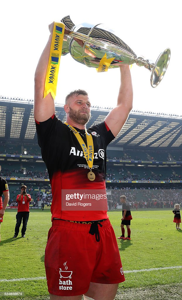 <a gi-track='captionPersonalityLinkClicked' href=/galleries/search?phrase=George+Kruis&family=editorial&specificpeople=6179640 ng-click='$event.stopPropagation()'>George Kruis</a> of Saracens celebrates with the trophy after the Aviva Premiership final match between Saracens and Exeter Chiefs at Twickenham Stadium on May 28, 2016 in London, England.