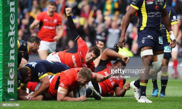 George Kruis of Saracens crashes over to score his team's second try during the European Rugby Champions Cup Final between ASM Clermont Auvergne and...