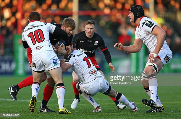 George Kruis of Saracens is tackled by Paddy Jackson and Craig Gilroy of Ulster Rugby during the European Rugby Champions Cup pool one match between...