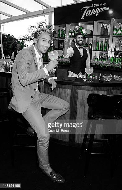 George Lamb attends as Tanqueray Gin brand ambassador Barrie Wilson mixes drinks in the Tanqueray Terrace during day 2 of the Diageo Reserve WORLD...