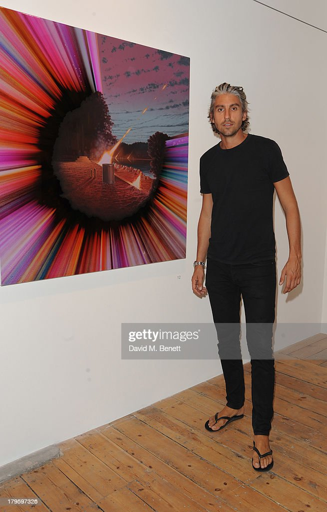 <a gi-track='captionPersonalityLinkClicked' href=/galleries/search?phrase=George+Lamb&family=editorial&specificpeople=2011003 ng-click='$event.stopPropagation()'>George Lamb</a> attends the VIP launch of the 'Hand To Earth' exhibition hosted by Matthew Williamson at Scream Gallery on September 5, 2013 in London, England.