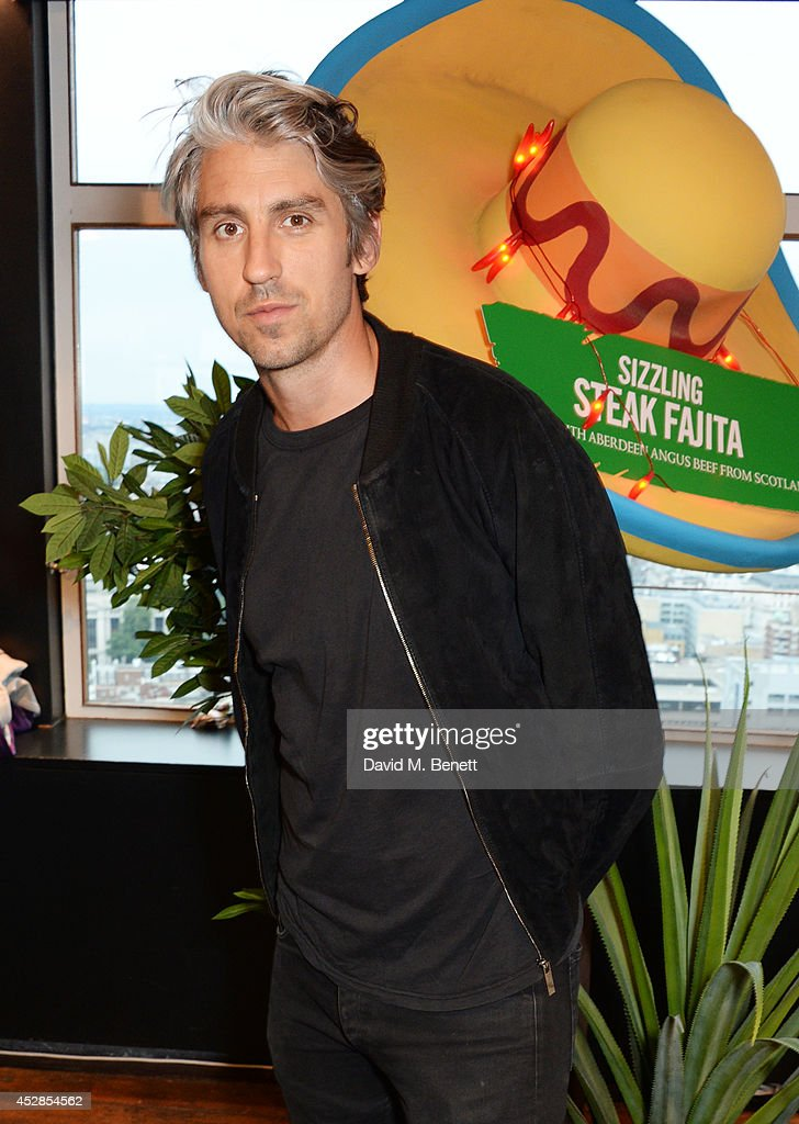 George Lamb attends the 'Walkers 'Do Us A Flavour' finalists launch at Paramount Centre Point on July 28 2014 in London England