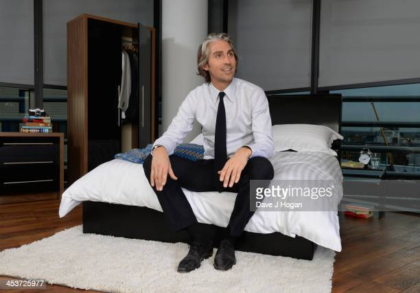 George Lamb poses for a photograph to celebrate the launch of the Essential Design Guide For Men on November 7 2013 in London England Our house in...