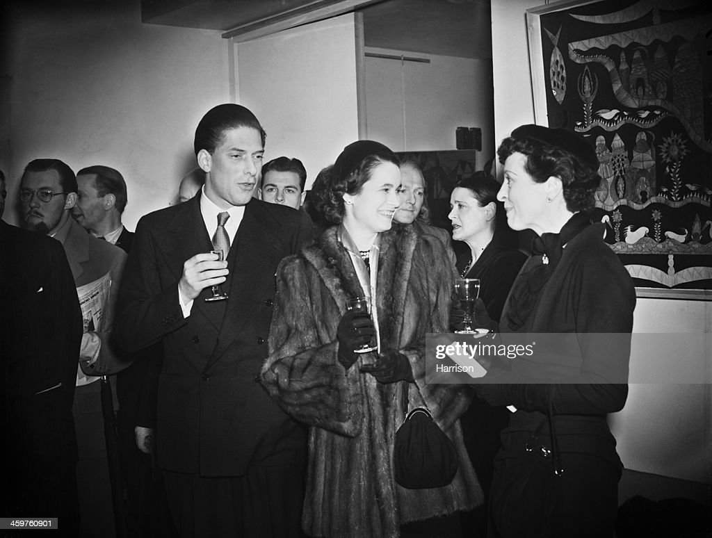 George Lascelles 7th Earl of Harewood and his wife Marion Stein Countess of Harewood talking to English stage actress Margaret Rawlings at the...