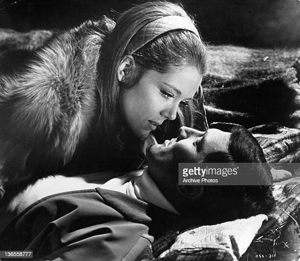 George Lazenby and Diana Rigg find shelter in a deserted barn to make love in a scene from the film 'On Her Majesty's Secret Service' 1969