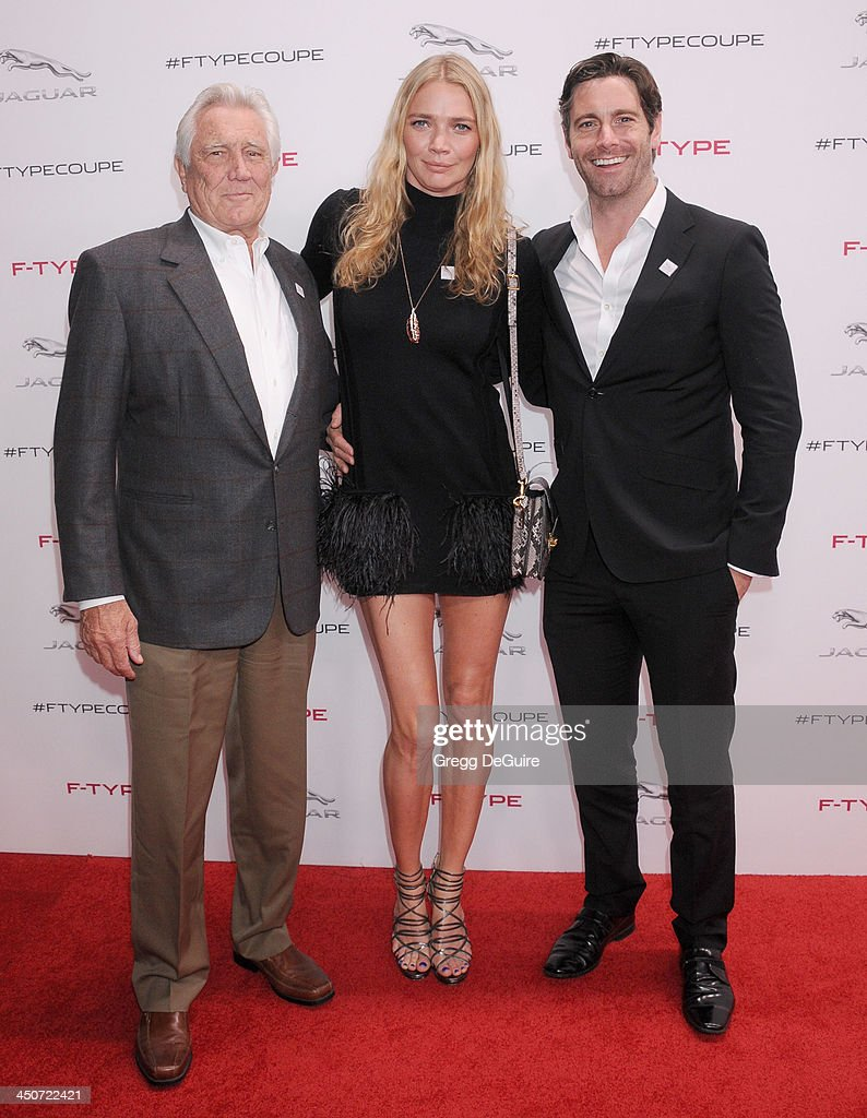 George Lazenby, Jodie Kidd and David Blakeley arrive at the Jaguar F-TYPE Coupe launch party at Raleigh Studios on November 19, 2013 in Playa Vista, California.