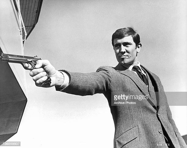 George Lazenby takes aim as he has a showdown with Spectre Chief Blofeld in a scene from the film 'On Her Majesty's Secret Service' 1969