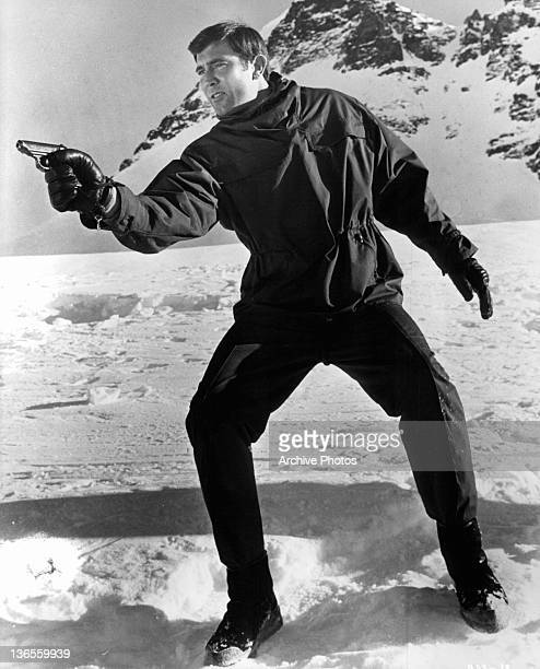 George Lazenby takes aim at his pursuers in a scene from the film 'On Her Majesty's Secret Service' 1969
