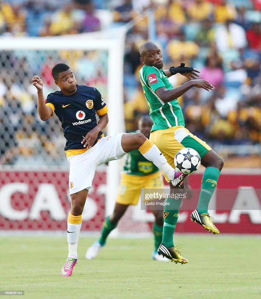 George Lebese and Thanduyise Khuboni go for the ball during the Absa Premiership match between Golden Arrows and Kaizer Chiefs at Moses Mabhida Stadium on April 06, 2013 in Durban, South Africa.