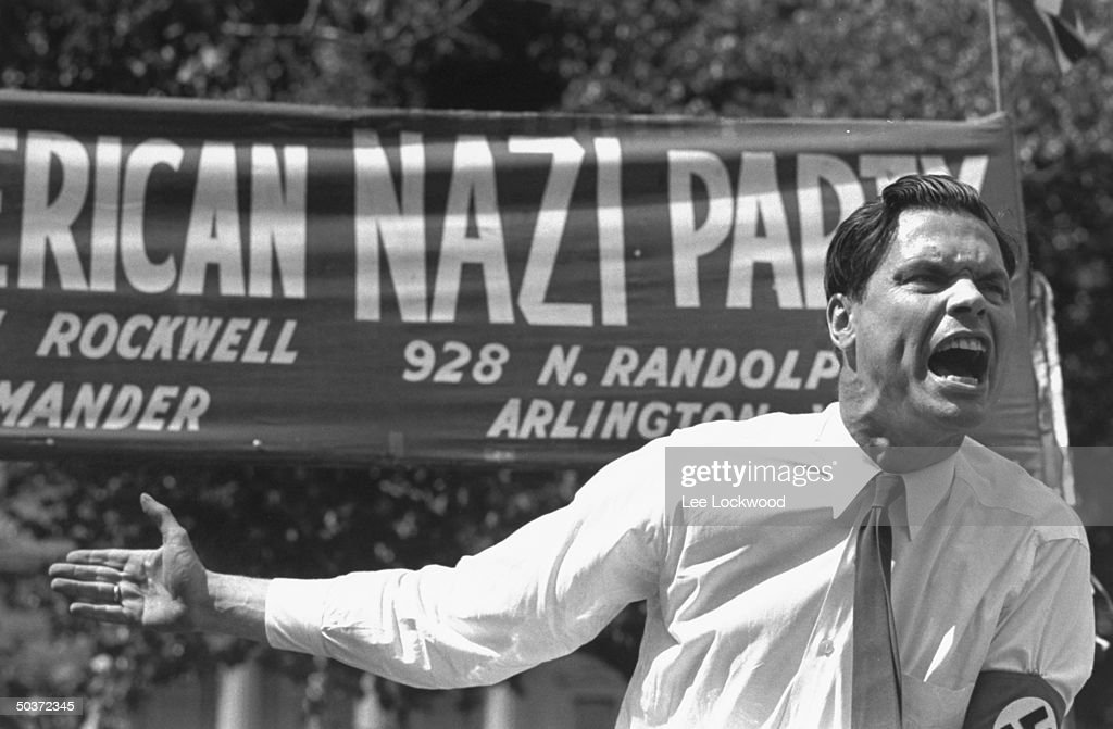 George Lincoln Rockwell, head of the American Nazi Party, appears to be ranting during podium speech.