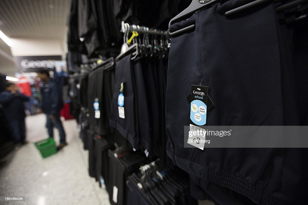 A 'George' logo sits on a label for a pair of boys stain resistant school uniform trousers displayed for sale inside an Asda supermarket chain, the U.K. retail arm of Wal-Mart Stores Inc., in Watford, U.K., on Thursday, Oct. 17, 2013. U.K. retail sales rose more than economists forecast in September as an increase in furniture demand led a rebound from a slump the previous month. Photographer: Simon Dawson/Bloomberg via Getty Images