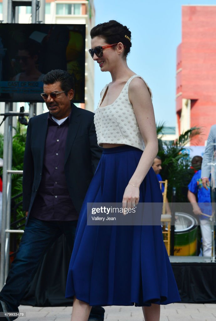 George Lopez and Anne Hathaway attend Miami Walk Of Fame unveiling at Bayside Marketplace on March 21, 2014 in Miami, Florida.