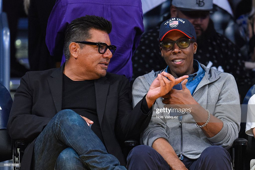 George Lopez and Arsenio Hall attend a basketball game between the New Orleans Pelicans and the Los Angeles Lakers at Staples Center on April 1 2015...