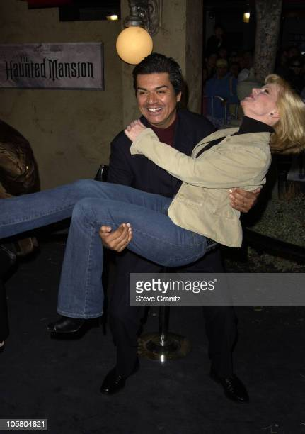 George Lopez and Bonnie Hunt during 'The Haunted Mansion' World Premiere at El Capitan Theatre in Hollywood California United States