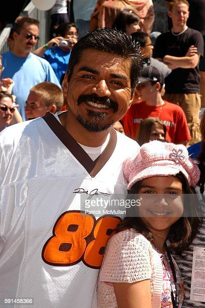 George Lopez and daughter attends Herbie Fully Loaded Movie Premiere at El Capitan Theatre on June 19 2005 in Hollywood CA