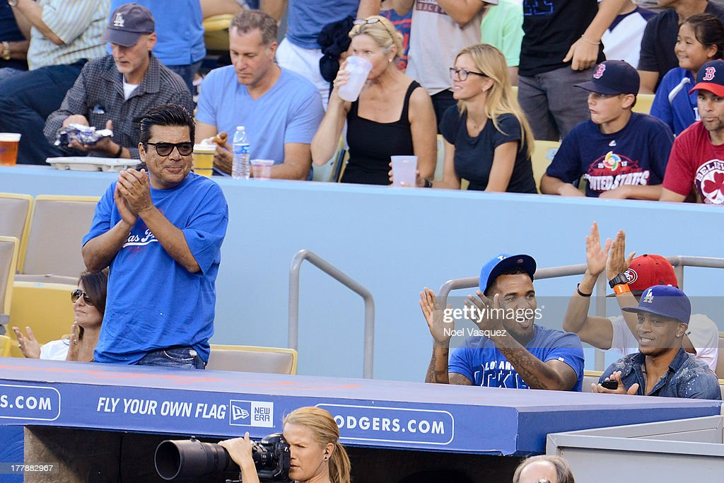 <a gi-track='captionPersonalityLinkClicked' href=/galleries/search?phrase=George+Lopez&family=editorial&specificpeople=202546 ng-click='$event.stopPropagation()'>George Lopez</a> (L) and The Game attend a baseball game between the Boston Red Sox and the Los Angeles Dodgers at Dodger Stadium on August 25, 2013 in Los Angeles, California.