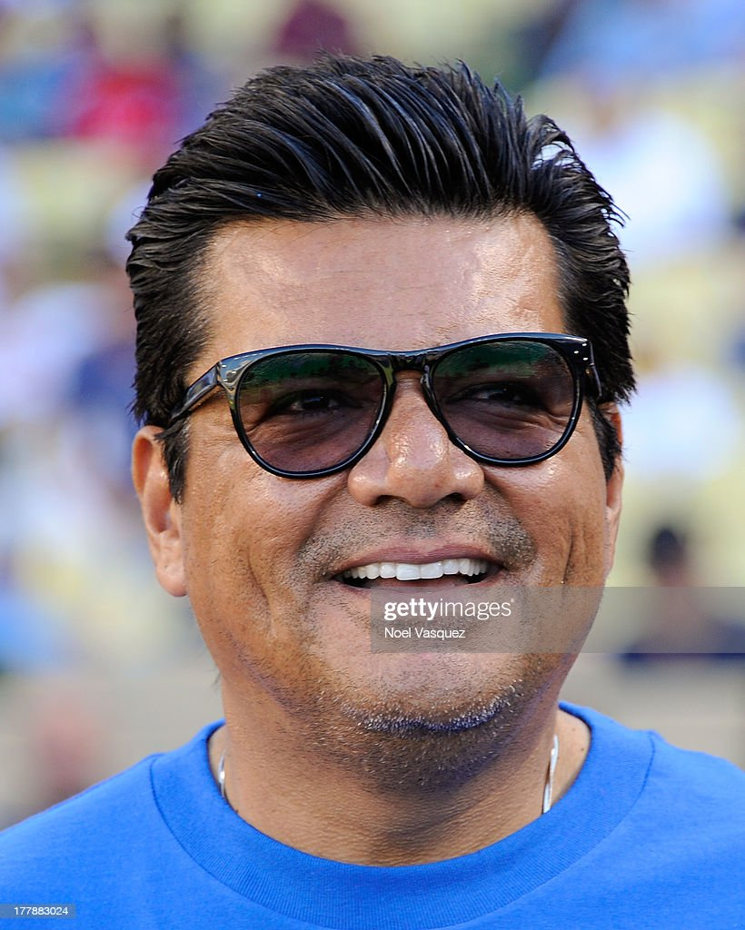 <a gi-track='captionPersonalityLinkClicked' href=/galleries/search?phrase=George+Lopez&family=editorial&specificpeople=202546 ng-click='$event.stopPropagation()'>George Lopez</a> attends a baseball game between the Boston Red Sox and the Los Angeles Dodgers at Dodger Stadium on August 25, 2013 in Los Angeles, California.