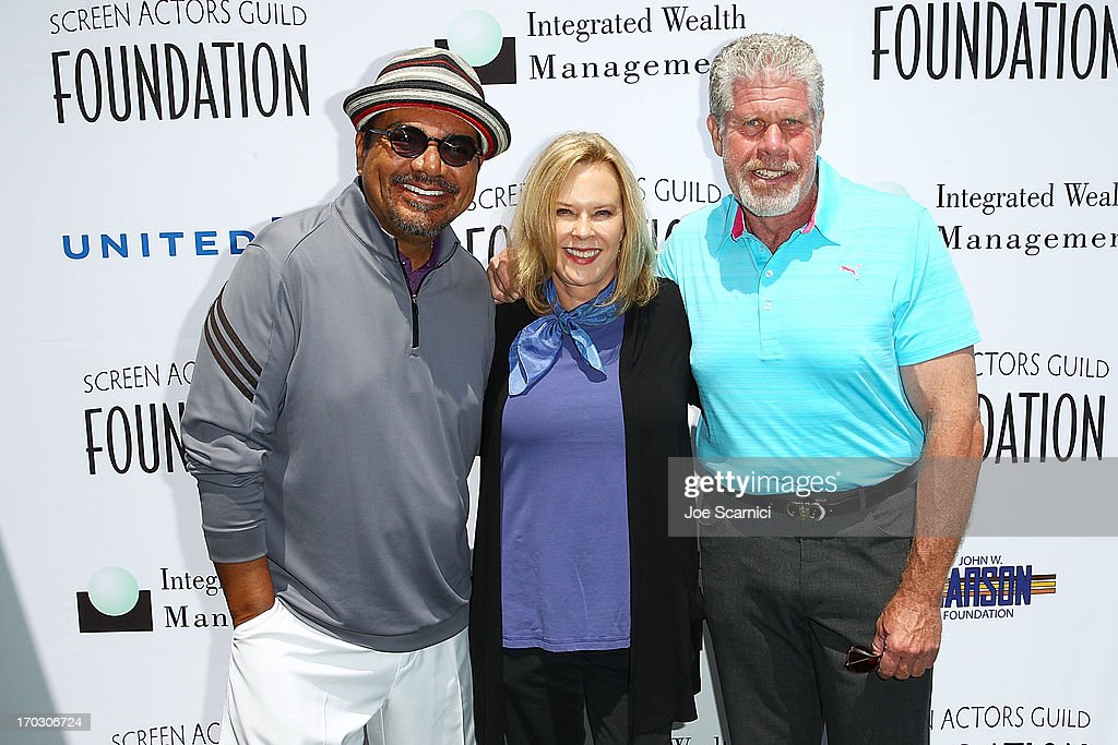 George Lopez, JoBeth Williams and Ron Perlman arrive to the Screen Actors Guild Foundation's 4th annual Los Angeles golf classic at Lakeside Golf Club on June 10, 2013 in Burbank, California.