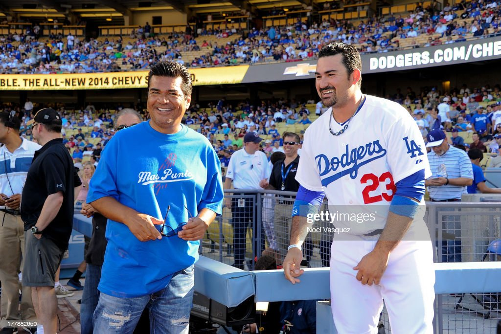 George Lopez speaks to Adrian Gonzalez at a baseball game between the Boston Red Sox and the Los Angeles Dodgers at Dodger Stadium on August 25 2013...