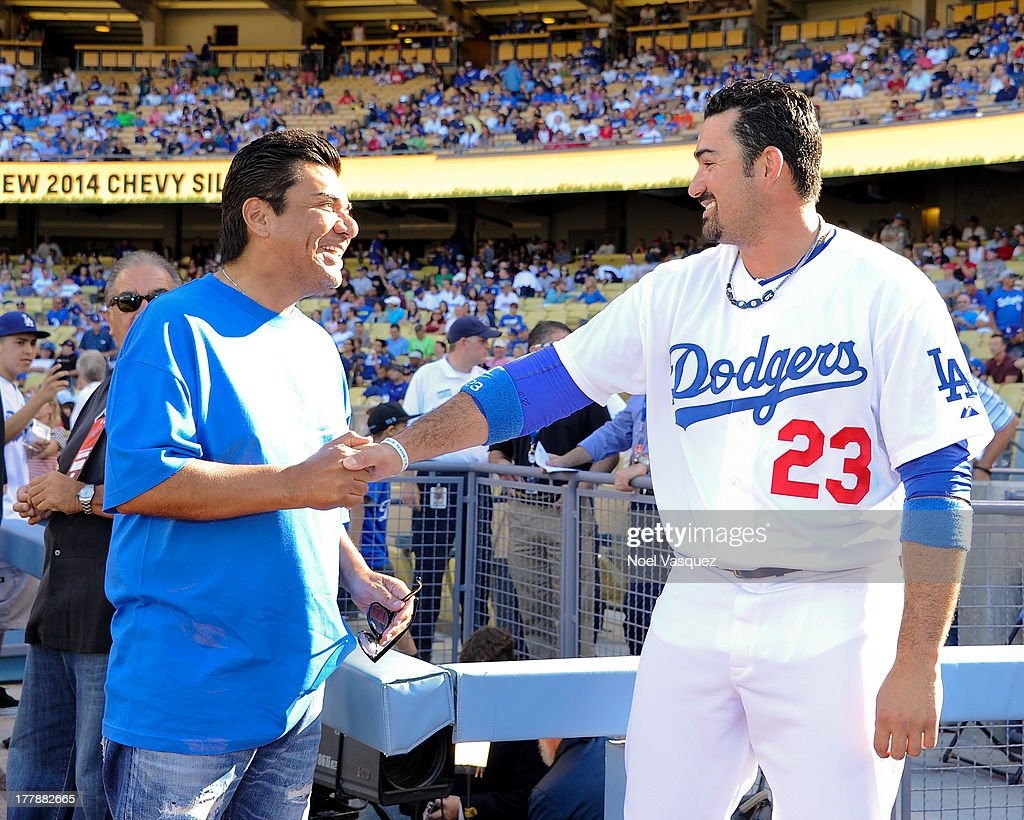 <a gi-track='captionPersonalityLinkClicked' href=/galleries/search?phrase=George+Lopez&family=editorial&specificpeople=202546 ng-click='$event.stopPropagation()'>George Lopez</a> speaks to Adrian Gonzalez at a baseball game between the Boston Red Sox and the Los Angeles Dodgers at Dodger Stadium on August 25, 2013 in Los Angeles, California.