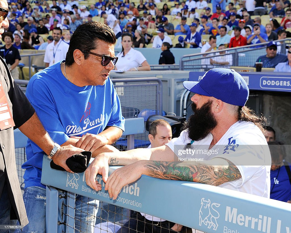 <a gi-track='captionPersonalityLinkClicked' href=/galleries/search?phrase=George+Lopez&family=editorial&specificpeople=202546 ng-click='$event.stopPropagation()'>George Lopez</a> speaks with Brian Wilson attends a baseball game between the Boston Red Sox and the Los Angeles Dodgers at Dodger Stadium on August 25, 2013 in Los Angeles, California.
