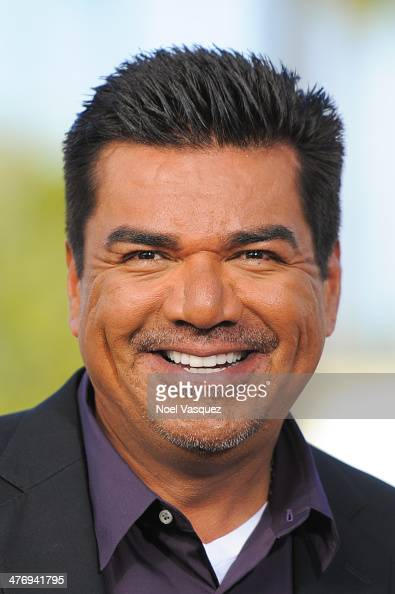 George Lopez visits 'Extra' at Universal Studios Hollywood on March 5 2014 in Universal City California