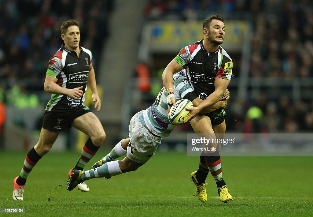 George Lowe of Harlequins is tackled by Jonathan Joseph of London Irish during the Aviva Premiership match between Harlequins and London Irish at Twickenham Stadium on December 29, 2012 in London, England.
