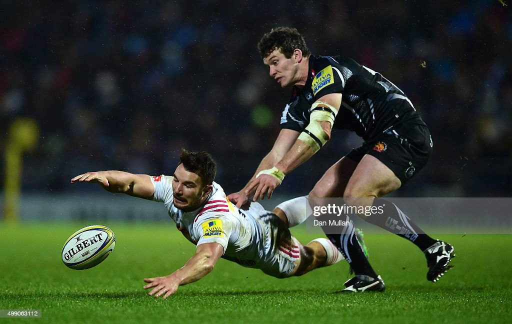 George Lowe of Harlequins loses control of the ball under pressure from Ian Whitten of Exeter Chiefs during the Aviva Premiership match between...
