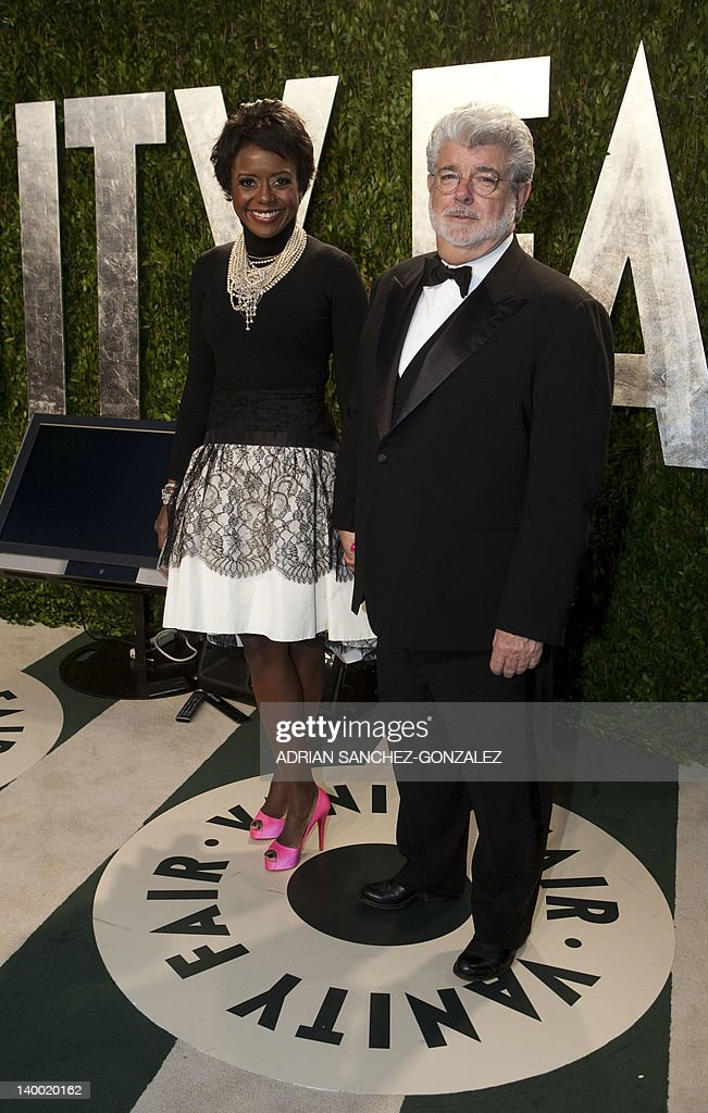 George Lucas (R) and girlfriend Mellody Hobson arrive at the Vanity Fair Oscar Party, for the 84th Annual Academy Awards, at the Sunset Tower on February 26, 2012 in West Hollywood, California. GONZALEZ