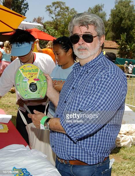 George Lucas with Tamagotchi Connection Virtual Pet