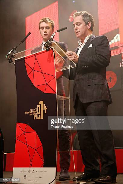 George Mackay and Tom Hollander on stage during The Moet British Independent Film Awards at Old Billingsgate Market on December 7 2014 in London...