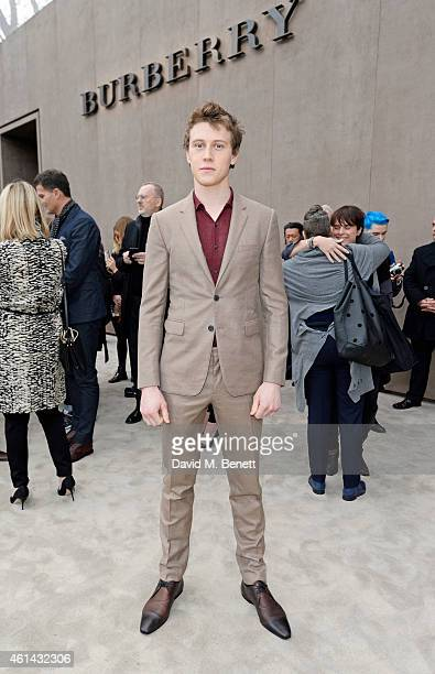 George Mackay arrives at Burberry Prorsum AW15 London Collections Men at Kensington Gardens on January 12 2015 in London England