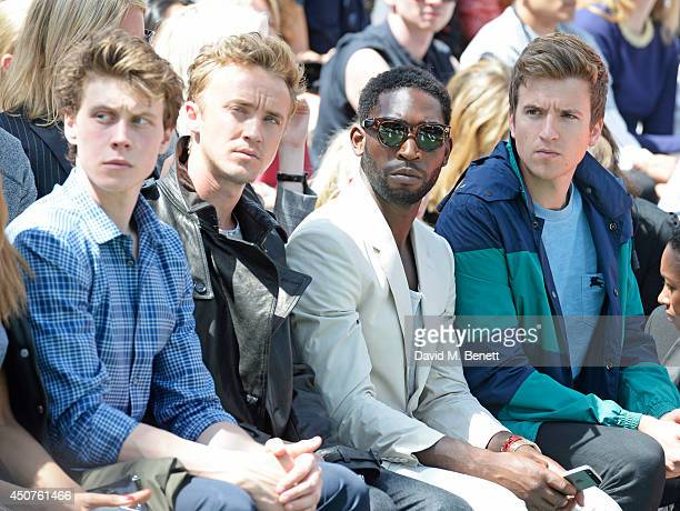 George MacKay Tom Felton Tinie Tempah and Greg James attend the front row at Burberry Prorsum SS15 during London Collections Men at Kensington...