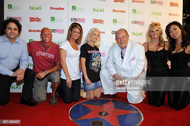 George Maloof Johnny Brenden Laura Croft Holly Madison and the Fantacy girls pose for photos with Robin Leach as he receives a star at the Brenden...