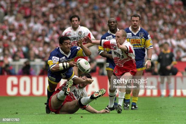 George Mann of Leeds drops the ball with Wigan captain Shaun Edwards right closing in