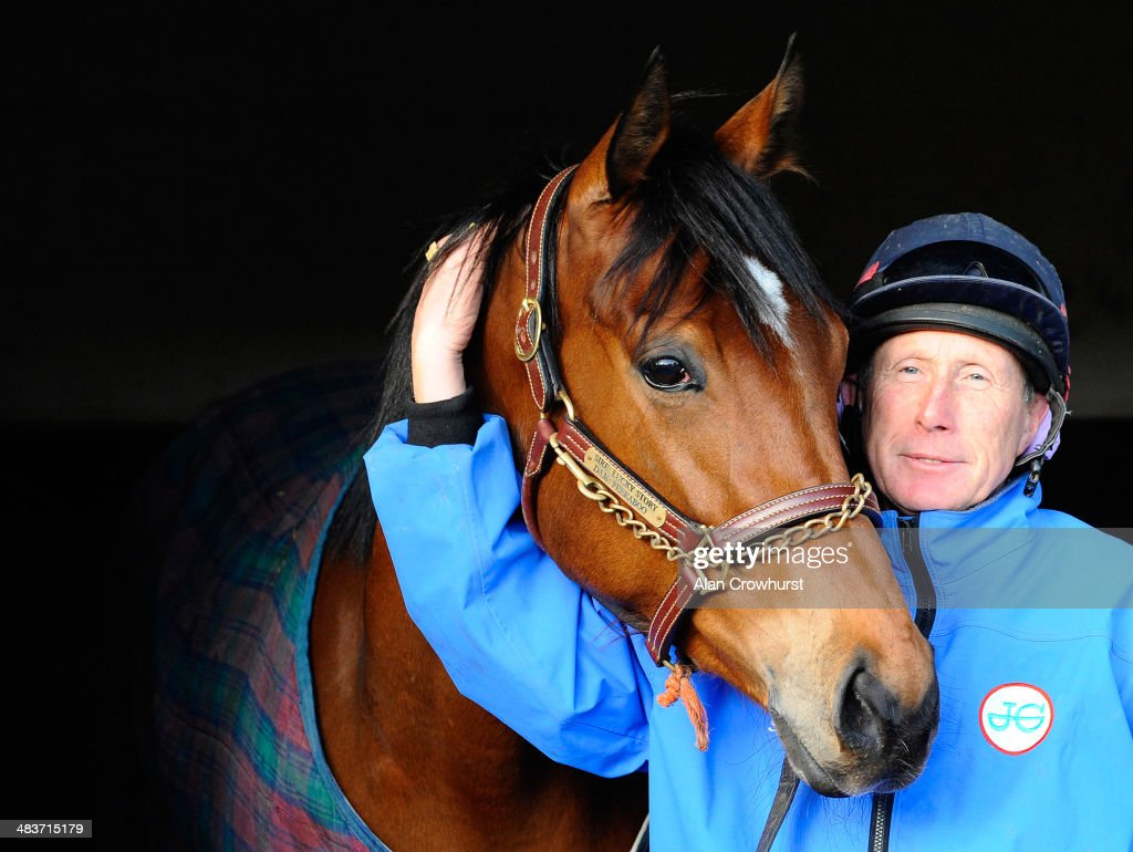 George Margarson poses with Lucky Kristale at Graham Lodge Stables in Newmarket on April 10, 2014 in Lingfield, England.