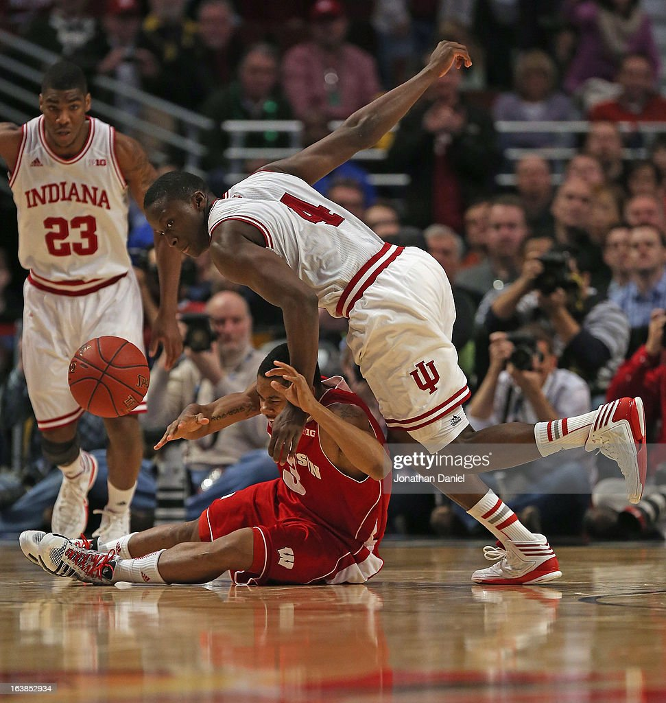 George Marshall #3 of the Wisconsin Badgers and <a gi-track='captionPersonalityLinkClicked' href=/galleries/search?phrase=Victor+Oladipo&family=editorial&specificpeople=6681560 ng-click='$event.stopPropagation()'>Victor Oladipo</a> #4 of the Indiana Hoosiers scramble for the ball as Remy Abell #23 of the Hoosiers watches from behind during a semifinal game of the Big Ten Basketball Tournament at the United Center on March 16, 2013 in Chicago, Illinois.