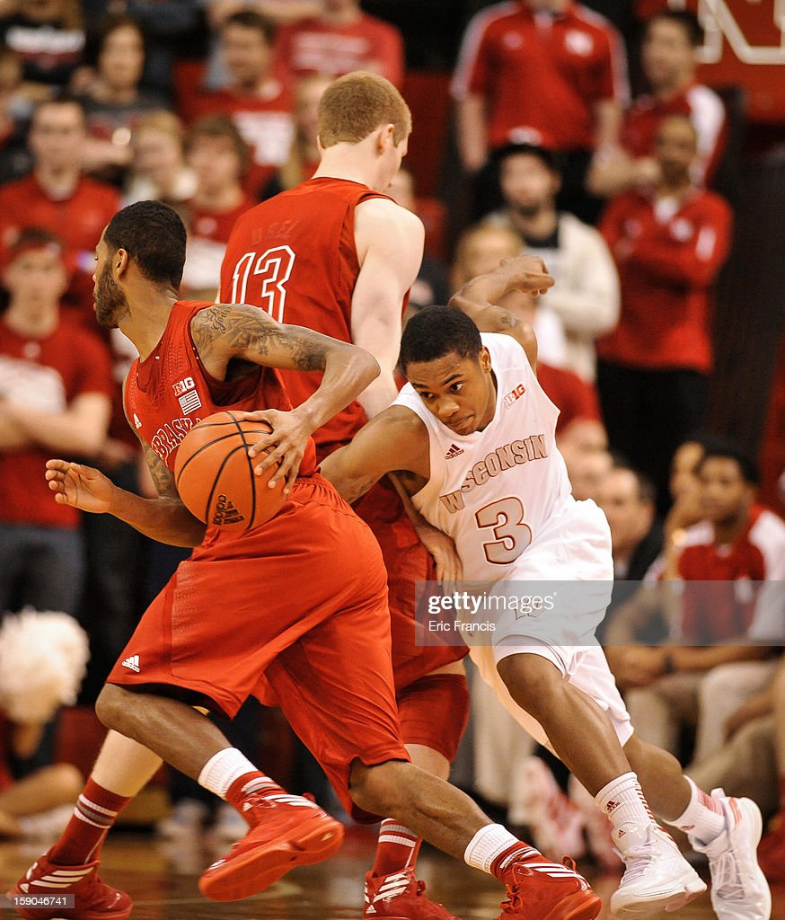George Marshall #3 of the Wisconsin Badgers works around a pick to keep up with Ray Gallegos #15 of the Nebraska Cornhuskers during their game at the Devaney Center on January 6, 2013 in Lincoln, Nebraska. Wisconsin defeated Nebraska 47-41.