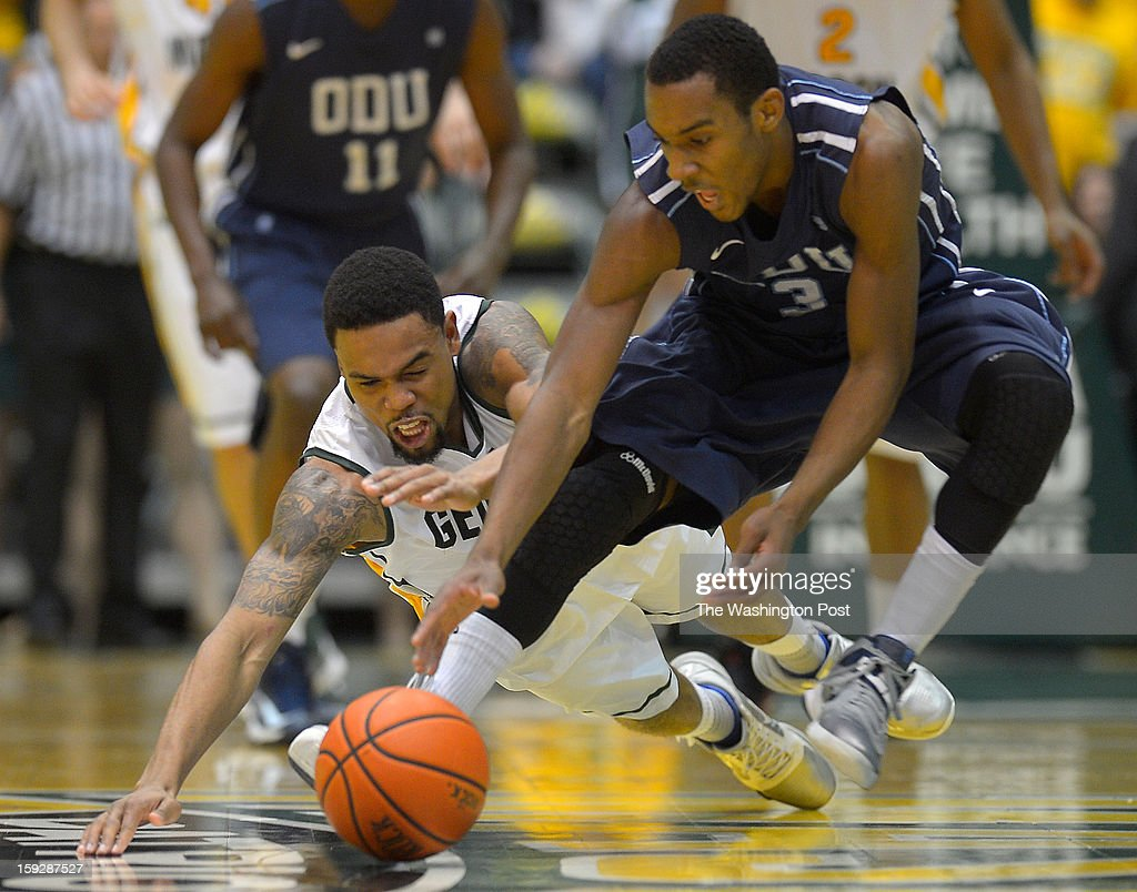 George Mason guard Sherrod Wright (10), left, and Old Dominion guard Keenan Palmore (3) scramble for a loose ball during the George Mason Patriots defeat of the Old Dominion Monarchs 71 - 46 in mens basketball at the Patriot Center in Fairfax VA, January 10, 2012 .