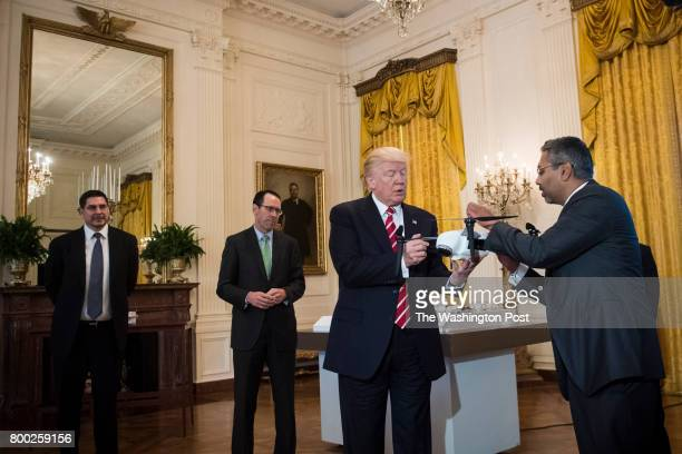 George Mathew CEO of Kespry shows a drone to President Donald Trump during the 'American Leadership in Emerging Technology' event in the East Room of...