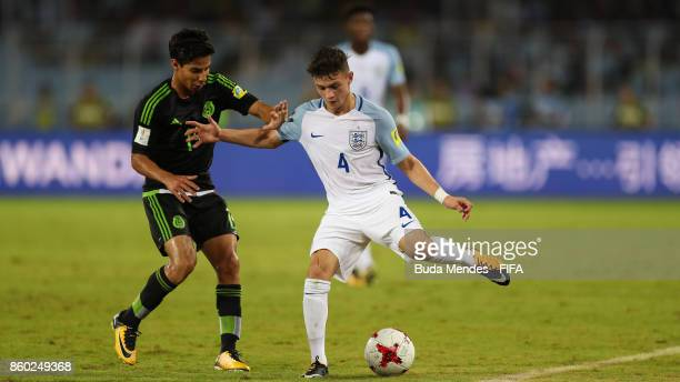 George McEachran of England battles for the ball with Diego Lainez of Mexico during the FIFA U17 World Cup India 2017 group F match between England...