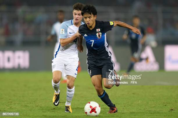 George McEachran of England battles for the ball with Takefusa Kubo of Japan during the FIFA U17 World Cup India 2017 Round of 16 match between...