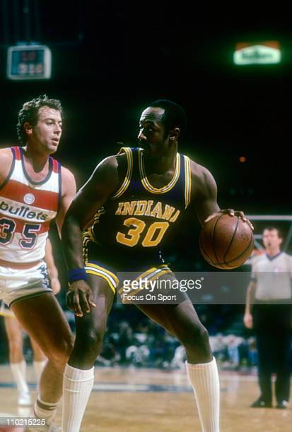 George McGinnis of the Indiana Pacers backs in on Kevin Grevey of the Washington Bullets during an NBA basketball game circa 1980 at the Baltimore...