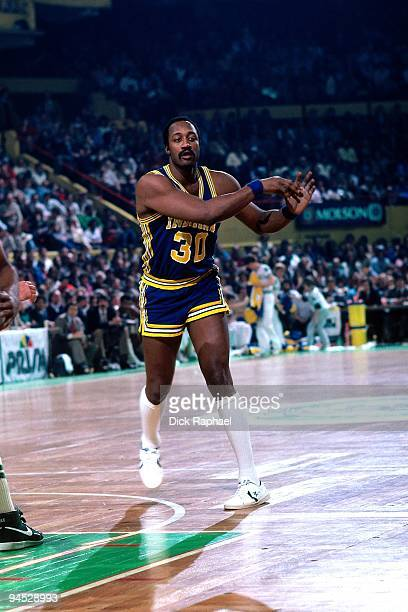 George McGinnis of the Indiana Pacers passes against the Boston Celtics during a game played in 1982 at the Boston Garden in Boston Massachusetts...